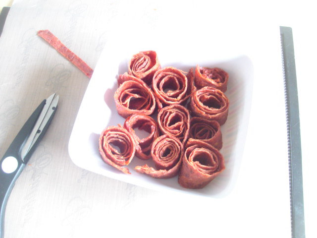 Foraged rosehips made into rolls of rosehip fruit leather
