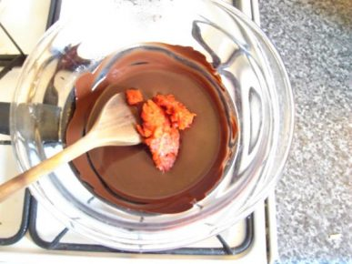 Stirring Rosehip flesh into melted chocolate