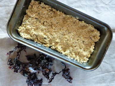 Dried dulse seaweed next to dulse soda bread before it is baked