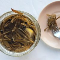 An opened jar of pickled rock samphire