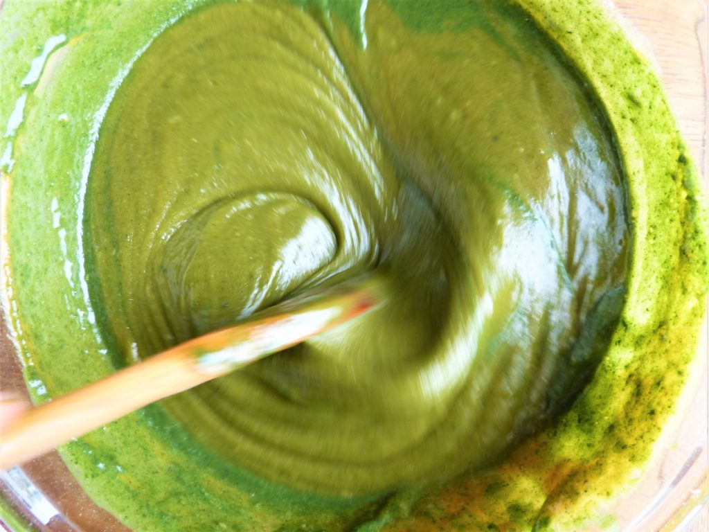 Beating wild, foraged nettle cake mixture