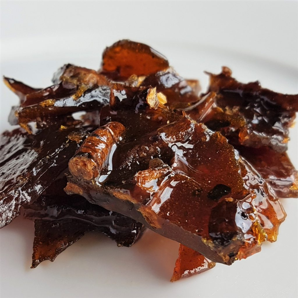 Chunky pieces of dandelion root caramel brittle