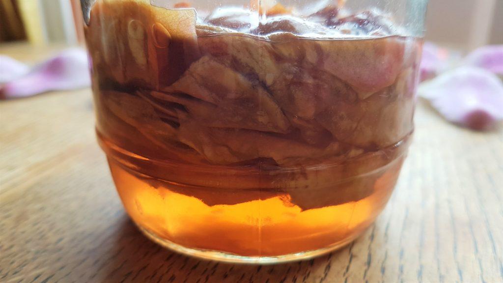 Jar of pickling magnolia petals