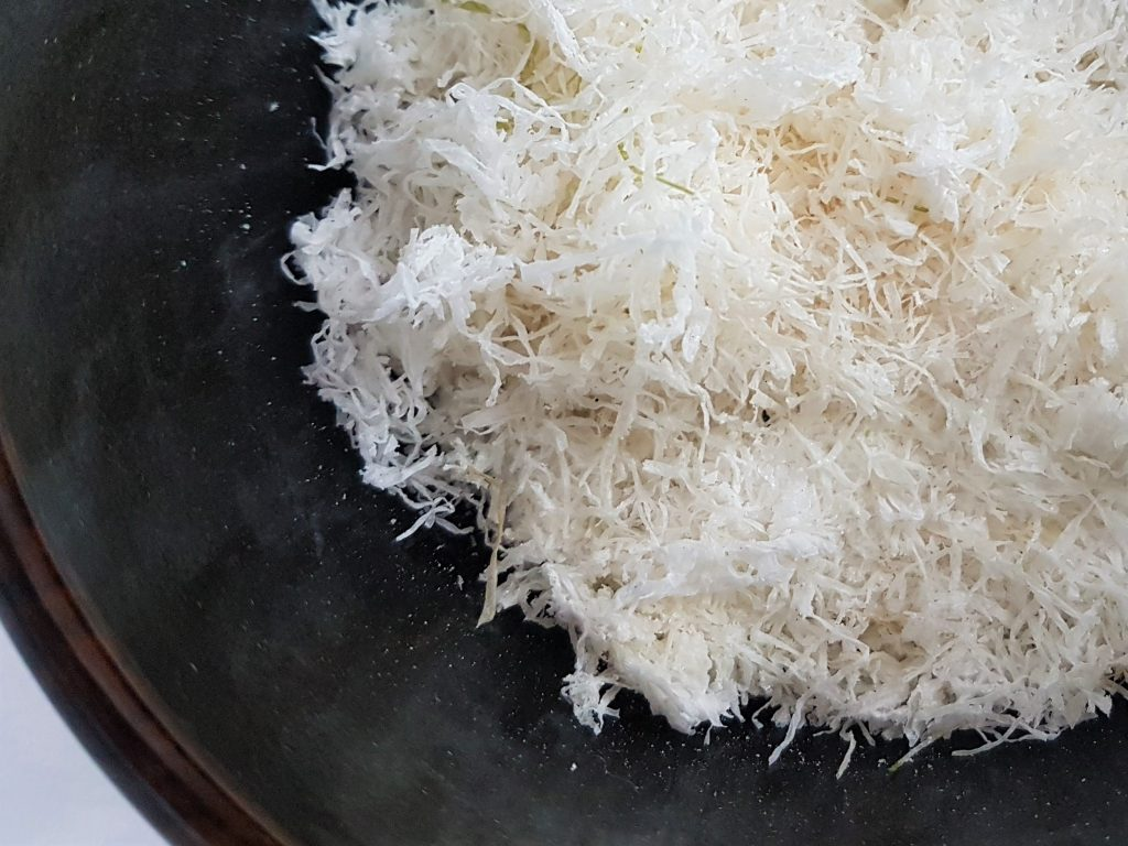 Bowl of shredded, naturally bleached and salty seaweed