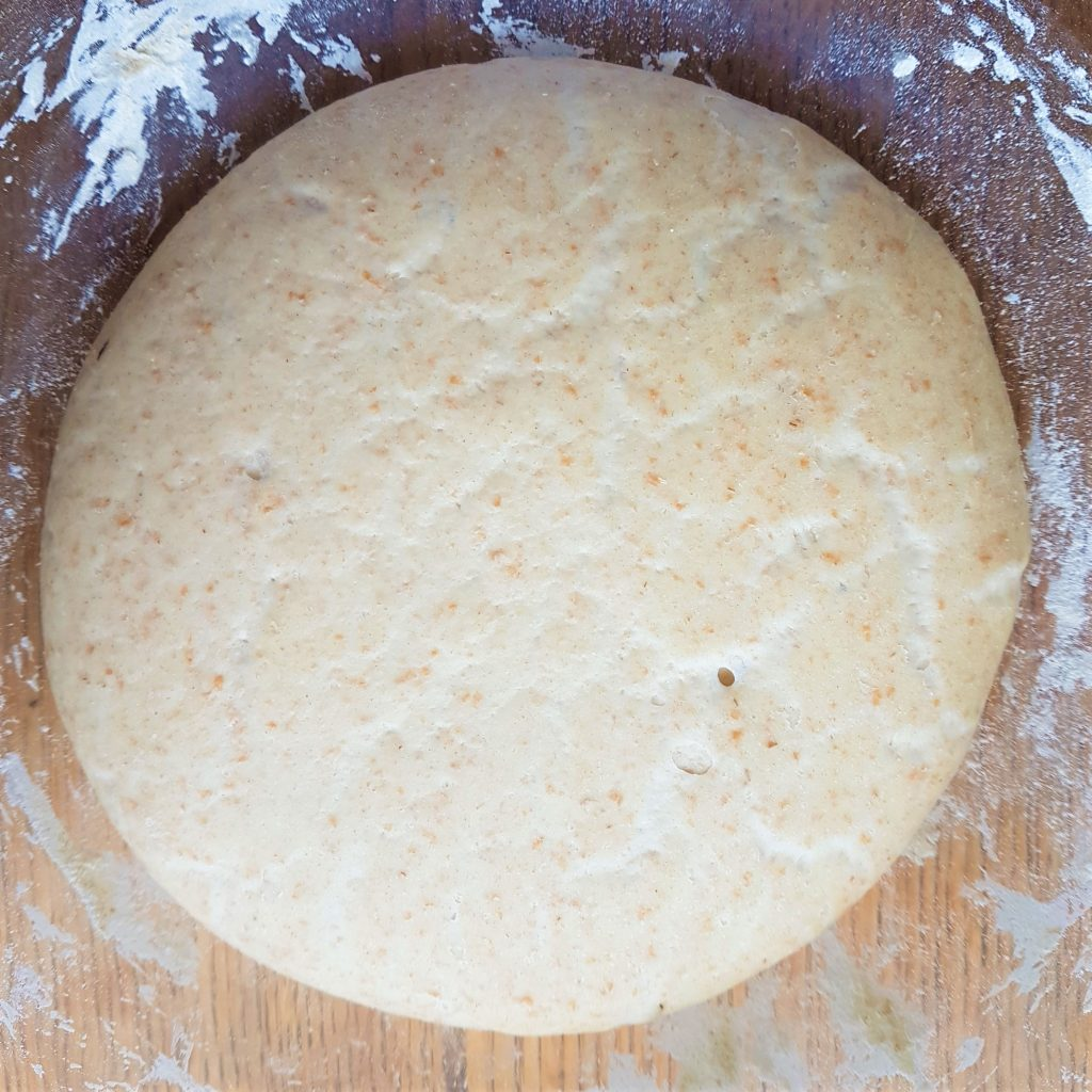 Risen dough ready to stretch for pizza making