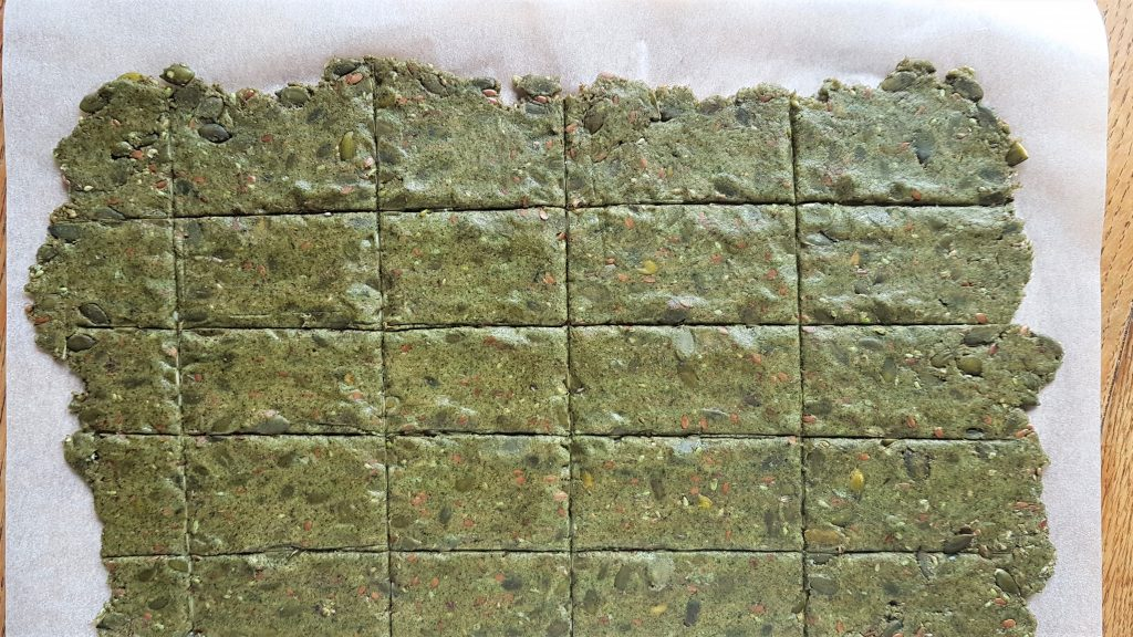 Nettle and plantain dough rolled out and cut, ready for baking