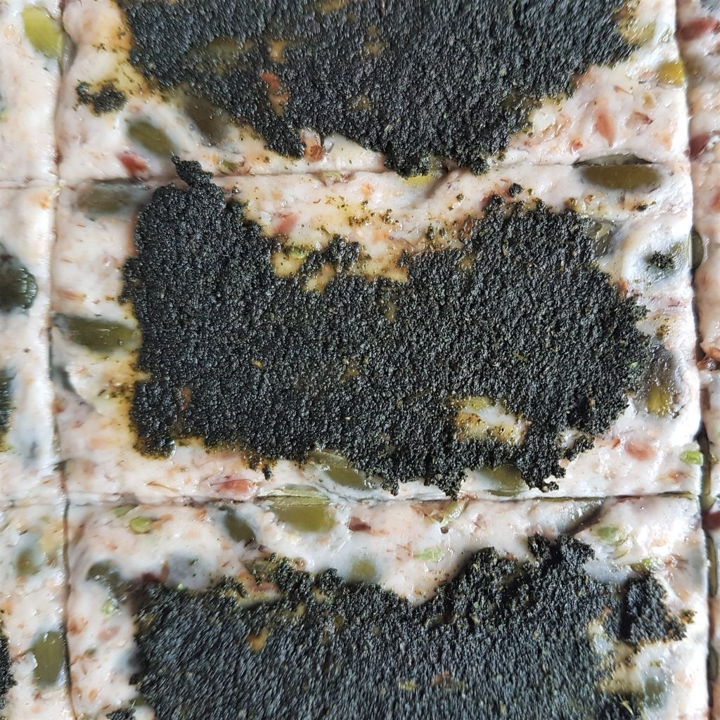 Homeamde crackers ready to bake with savoury nettle spread