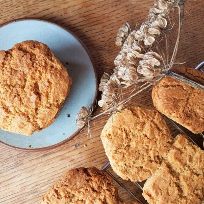 Freshly baked hogweed seed biscuits on plate and cooling rack