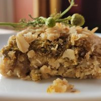 A piece of homemade pineapple weed flapjack with a jam centre