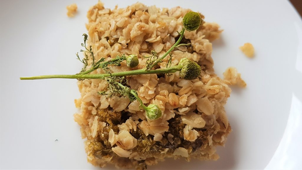 A square of homemade pineapple weed flapjack