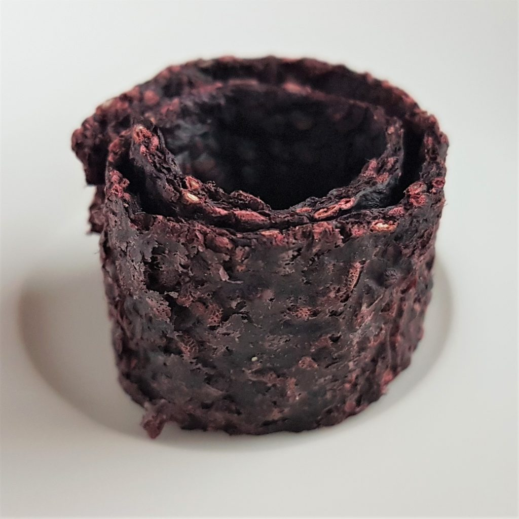 Rolls of dried blackberry fibre and seeds