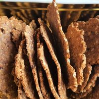 Tin box of homemade buckwheat, blackberry and dulse crackers