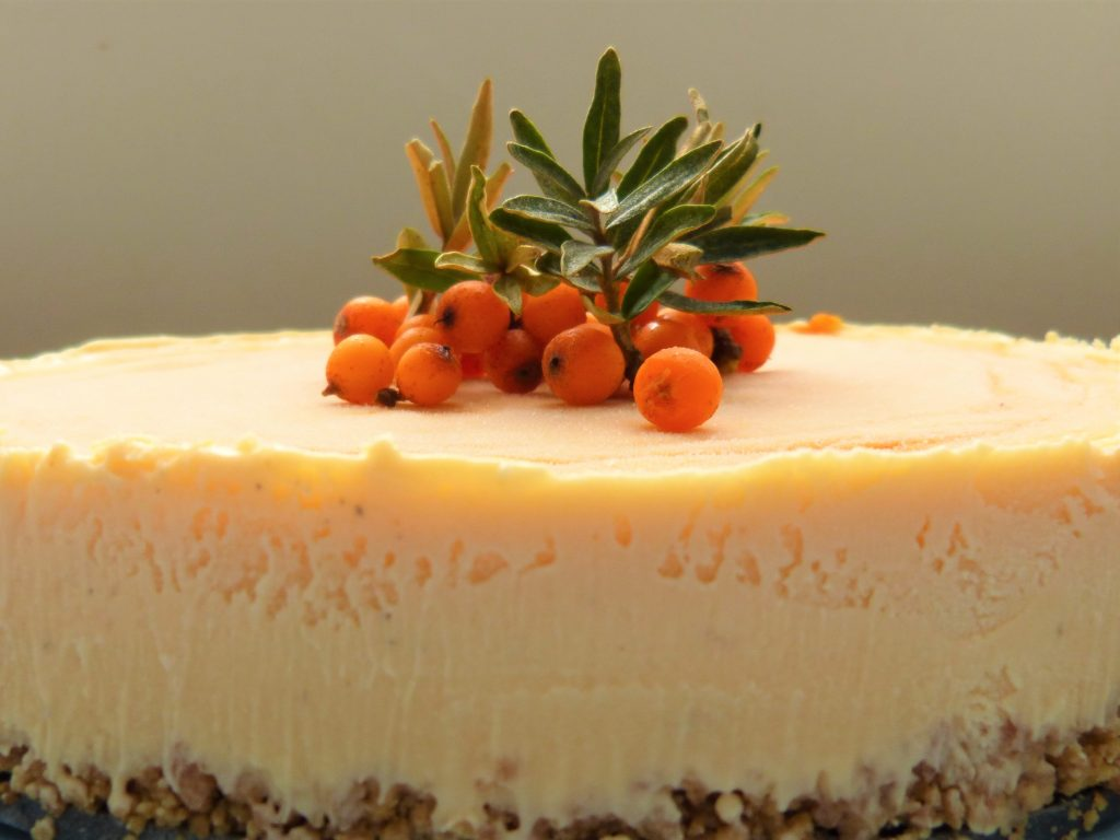 Half a froen sea buckthorn and ginger cheesecake