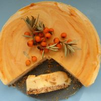 Sea buckthorn cheesecake with a slice on the side