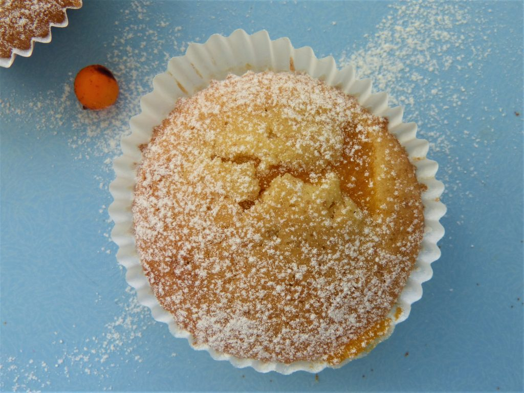 Single, home baked sea buckthorn cup cake