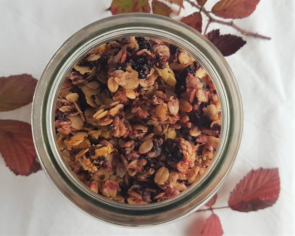 Large jar of blackberry seeded granola