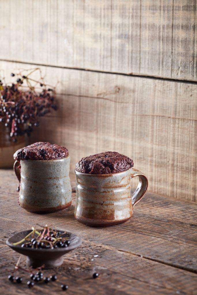 Mugs of chocolate and elderberry souffles
