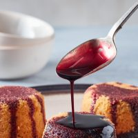 Spoonful of elderberry cordial drizzled over sponges