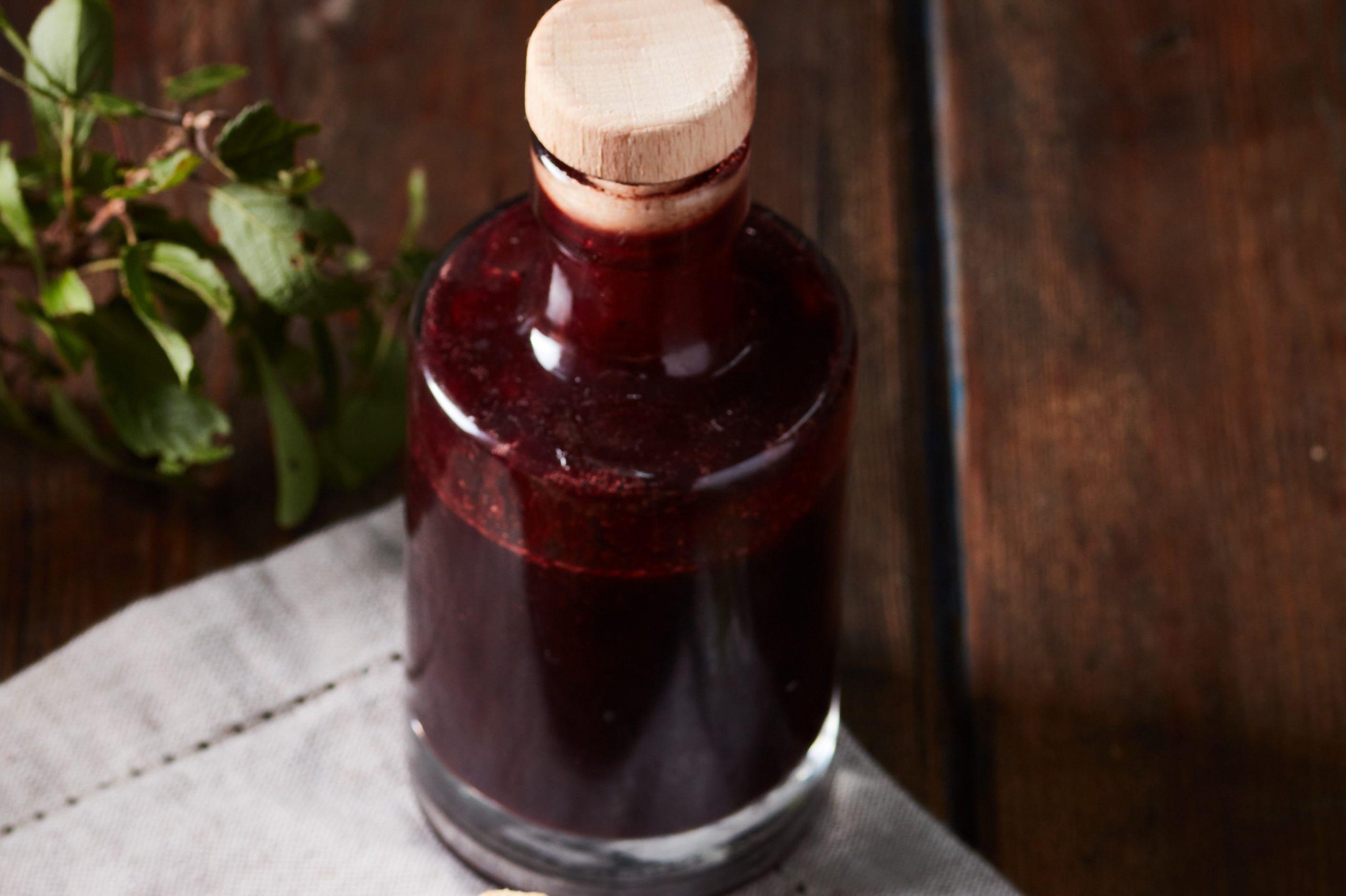 Bottle of homemade sloe syrup